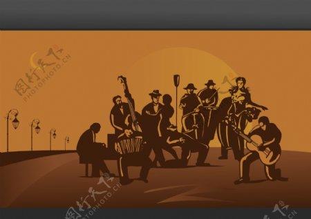 夜晚公路边的音乐乐队剪影图片